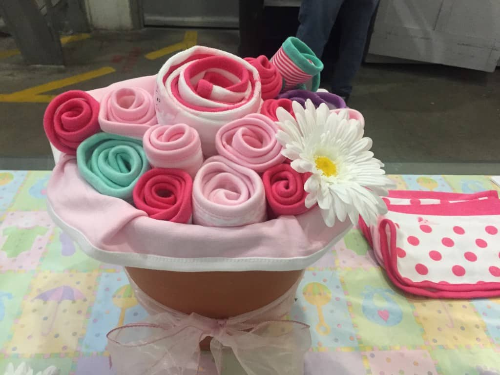 baby shower gift basket ideas - use a planter to hold blankets rolled to look like flowers
